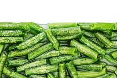 Border of wet fresh green french bean in water  closeup on white background. Royalty Free Stock Photography