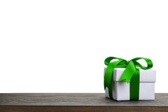 Border with white gift box with green ribbon bow Royalty Free Stock Photos