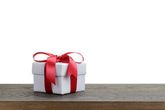 Border with white gift box with red ribbon bow Royalty Free Stock Photos