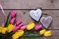 Border from yellow and pink spring tulips  and two decorative he Royalty Free Stock Images