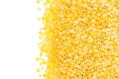 Border of yellow purified lentil closeup with copy space on white background. Royalty Free Stock Image