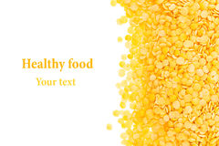 Border of yellow purified lentil closeup with copy space on white background. Royalty Free Stock Images