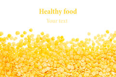 Border of yellow purified lentil closeup with copy space on white background. Stock Photos