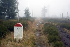 Borderline Bollard Along Footpath in Foggy Forest Royalty Free Stock Images