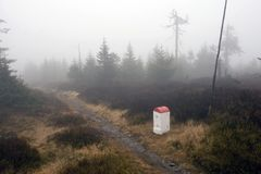 Borderline Bollard Along Footpath in Foggy Forest Royalty Free Stock Image