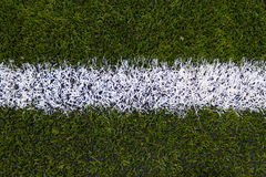 Borders the football field. Artificial turf Royalty Free Stock Photo