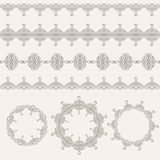 Borders and round frames set collection in calligraphic retro style  on beige background. Royalty Free Stock Images