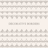 Borders set collection in calligraphic retro style  on beige background. Stock Image