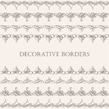 Borders set collection in calligraphic retro style isolated on beige background. Royalty Free Stock Photo