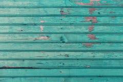 Bordi di legno anziani dipinti nel fondo blu Immagini Stock Libere da Diritti