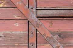 Bordi di legno e fondo della costruzione del ferro fotografia stock