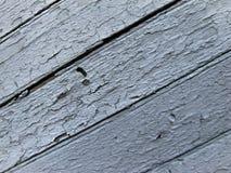 Bordi dipinti anziani in blu, fondo quattro fotografia stock
