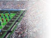 Bordlägga fotbollleksaken och fotbollbollen inom en verklig stadion Royaltyfri Foto