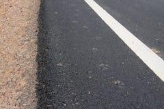 Bordo della strada dell'asfalto Immagine Stock
