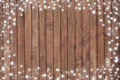Bordo di legno con i fiocchi della neve Immagini Stock