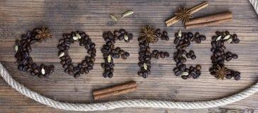 Bordo di legno con il caffè di parola Fotografie Stock