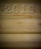 Bordo di legno con salotto 2016 sotto l'albero, parte posteriore di struttura Fotografie Stock
