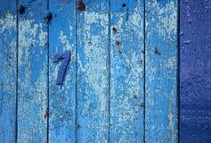 Bordo di legno d'annata blu nessun 7 Fotografia Stock