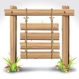 Bordo di legno del segno che appende con la corda su un'erba. Fotografia Stock