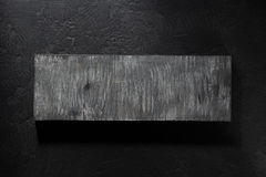 Bordo di legno a fondo nero Fotografia Stock Libera da Diritti