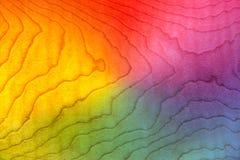 Bordo encaracolado da textura de madeira colorida do fundo, teste padrão da chama, figurado Fotografia de Stock Royalty Free
