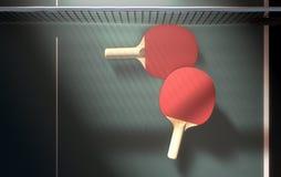 Bordtennistabell och skovlar Royaltyfri Foto