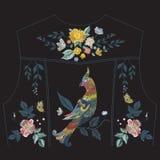 Borduurwerk bloemenpatroon met papegaai voor de rug van het jeansjasje Stock Foto