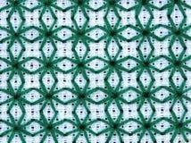 Borduurwerk in groen op het witte canvas Stock Fotografie