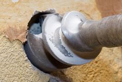 Bore. Strong steel bore on the wall Stock Image