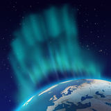 Borealis de la aurora de las luces norteñas sobre el planeta