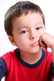 Bored. Five years old child  bored and looking at the camera Royalty Free Stock Photo