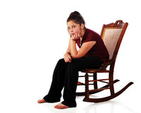 Bored!. A barefoot preteen totally bored while sitting in an old rocker.  Isolated on white Royalty Free Stock Photos