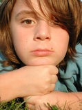 Bored. Macro of young boy model with bored expression Stock Images