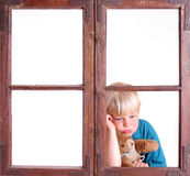Bored!. Bored child in a window royalty free stock photos