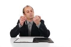 Bored. Badly bored businessman on    presentation Stock Photos
