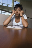 Bored African American Businesswoman At Desk Stock Photo