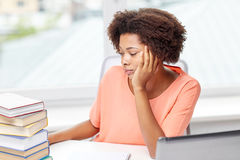 Bored african american woman doing homework home Royalty Free Stock Photos