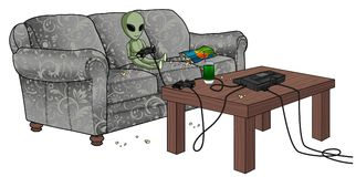 Bored Alien Playing Video games Stock Image