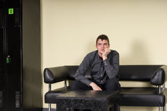 Bored or anxious man sitting in a waiting room Royalty Free Stock Images
