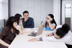 Bored asian business people at meeting.  Stock Photo