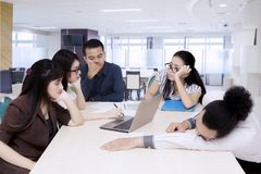 Bored asian business team at meeting.  Royalty Free Stock Image