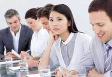 Bored asian businesswoman in a meeting Royalty Free Stock Photo