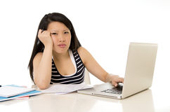 Bored asian woman student overworked on computer Royalty Free Stock Photography