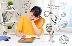 Bored asian woman student with tablet pc at home Royalty Free Stock Images