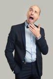 Bored bald stylish man yawning and looking up Stock Image