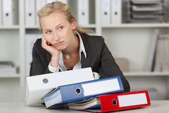 Bored Blond Businesswoman With Binders Stock Images