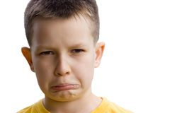 Bored Boy. Closeup portrait of preteen boy with a bored, displeased expression Royalty Free Stock Photos