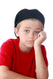 Bored Boy. Young preteen boy with bored expression on face, isolated on white Royalty Free Stock Photo