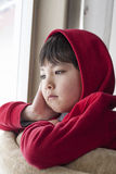 Bored boy looks outside. Royalty Free Stock Photos