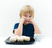 Bored boy with marshmallow Stock Images